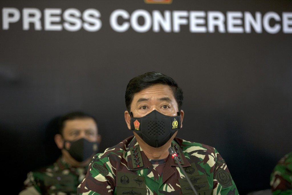 Indonesian Military chief Hadi Tjahjanto, right, talks to media during a press conference regarding its missing naval submarine in Bali, Indonesia on ...