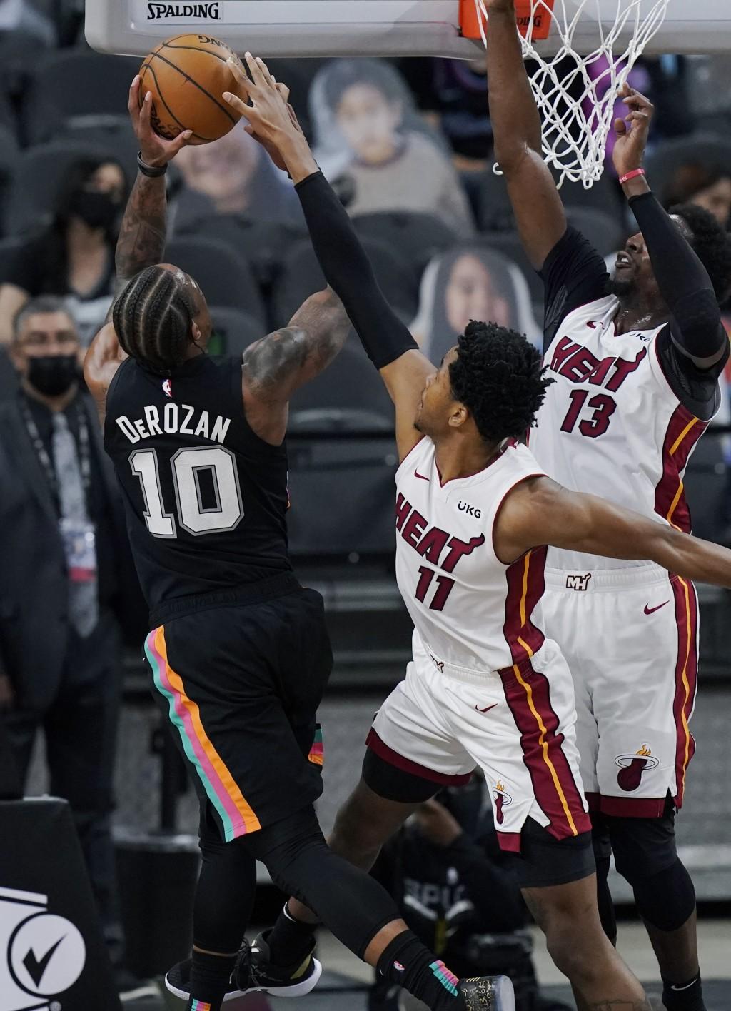 San Antonio Spurs forward DeMar DeRozan (10) is blocked by Miami Heat forward KZ Okpala (11) during the second half of an NBA basketball game in San A...