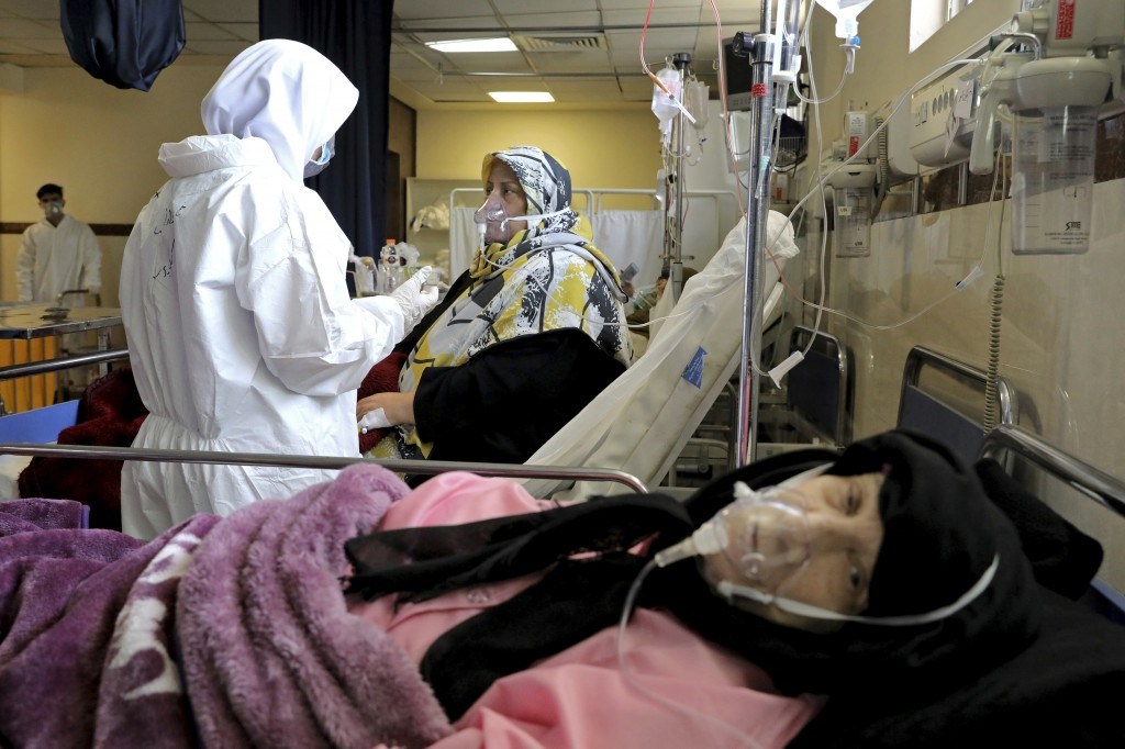 A nurse tends to a patient affected by the COVID-19 virus at the Shohadaye Tajrish Hospital in Tehran, Iran, Saturday, April 17, 2021. After facing cr...