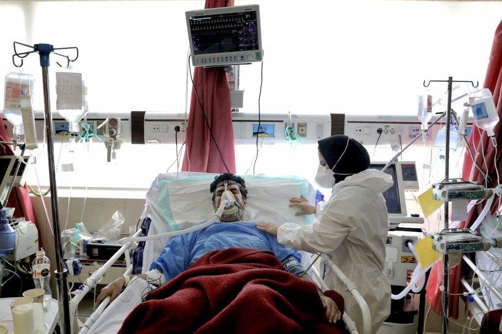 A nurse tends to a patient affected by COVID-19 at the Shohadaye Tajrish Hospital in Tehran, Iran, Saturday, April 17, 2021. After facing criticism fo...