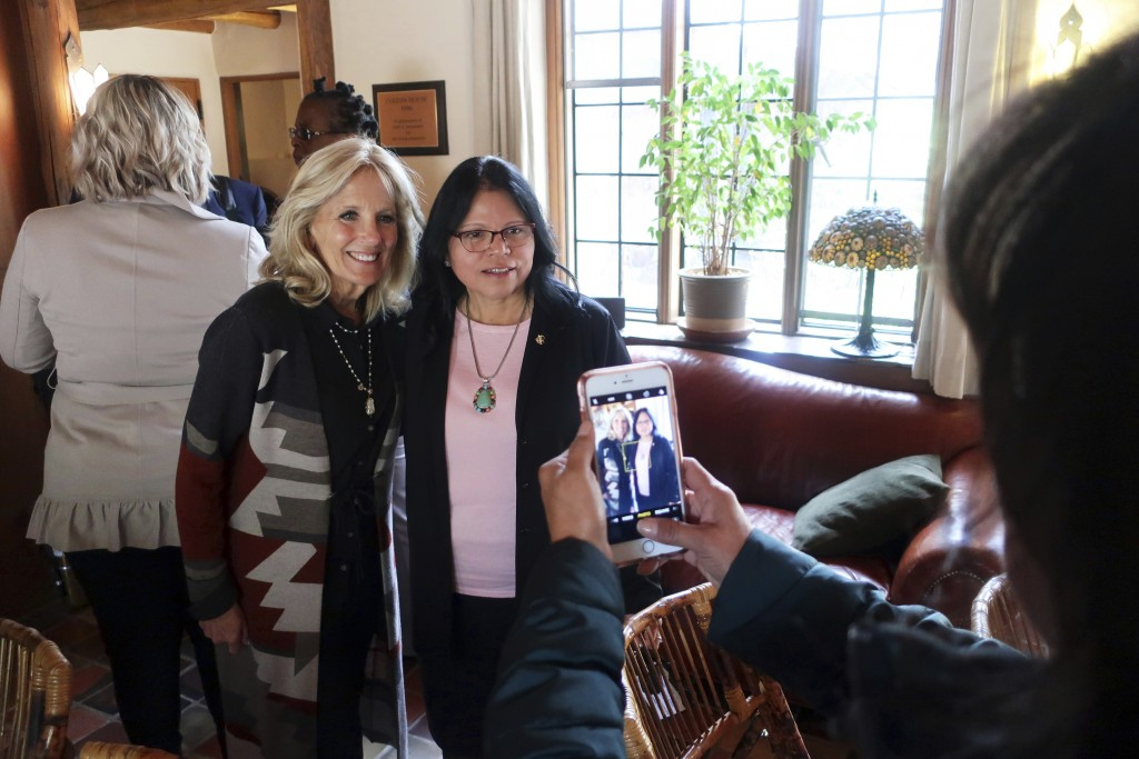 FILE - In this May 22, 2019, file photo, Jill Biden, left, and Tuba City Regional Health Care Corp. CEO Lynette Bonar pose for photos after an event i...