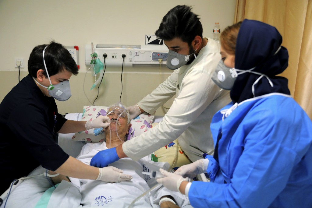 Medical personnel tend to a COVID-19 patient at the Shohadaye Tajrish Hospital in Tehran, Iran, Saturday, April 17, 2021. After facing criticism for d...