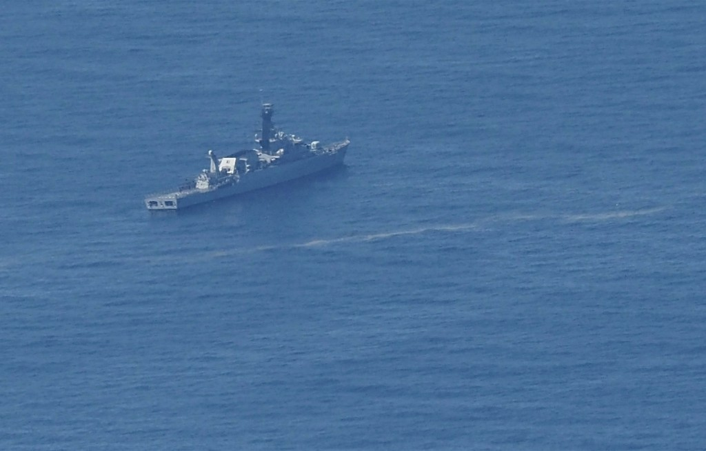 In this aerial photo taken from a maritime patrol aircraft of 800 Air Squadron of the 2nd Air Wing of Naval Aviation Center (PUSPENERBAL), an Indonesi...