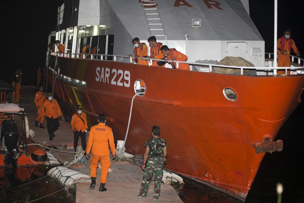 Members of National Search and Rescue Agency (BASARNAS) prepare for a search mission for The Indonesian Navy submarine KRI Nanggala at Benoa harbor in...