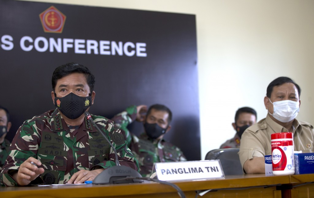 Indonesian Military chief Hadi Tjahjanto, left and Indonesian Defense Minister Prabowo Subianto, right, are seen during a press conference concerning ...
