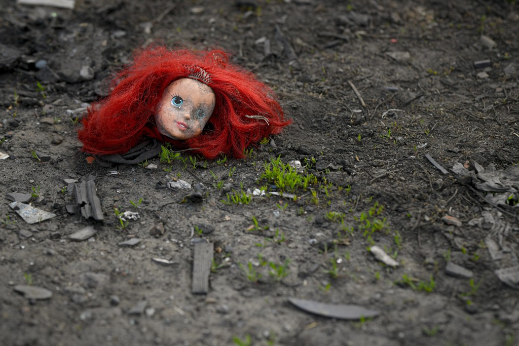 The head of a doll lies on the ground during a raid by the National Environmental Guard in Vidra, Romania, Tuesday, April 13, 2021. Many people in the...