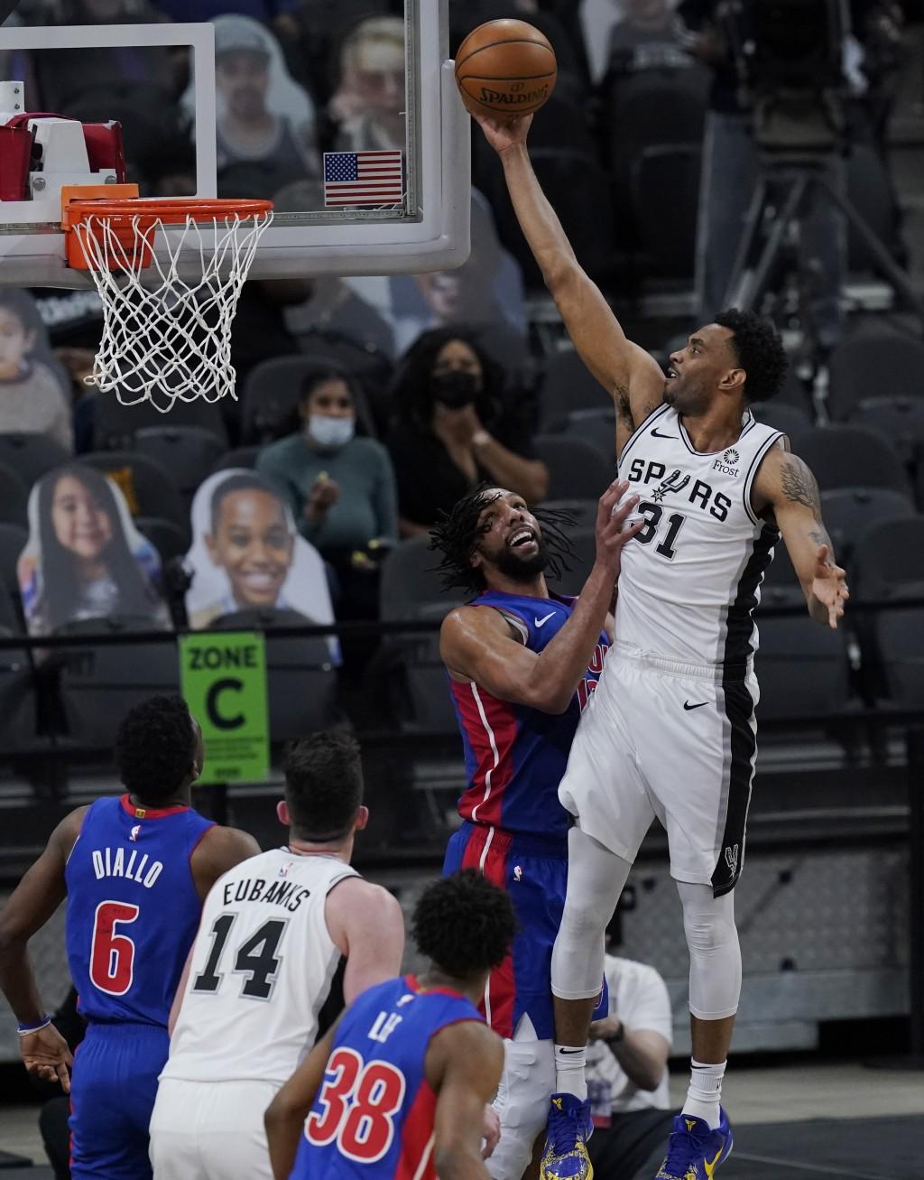 San Antonio Spurs forward Keita Bates-Diop (31) scores over Detroit Pistons center Jahlil Okafor (13) during the second half of an NBA basketball game...