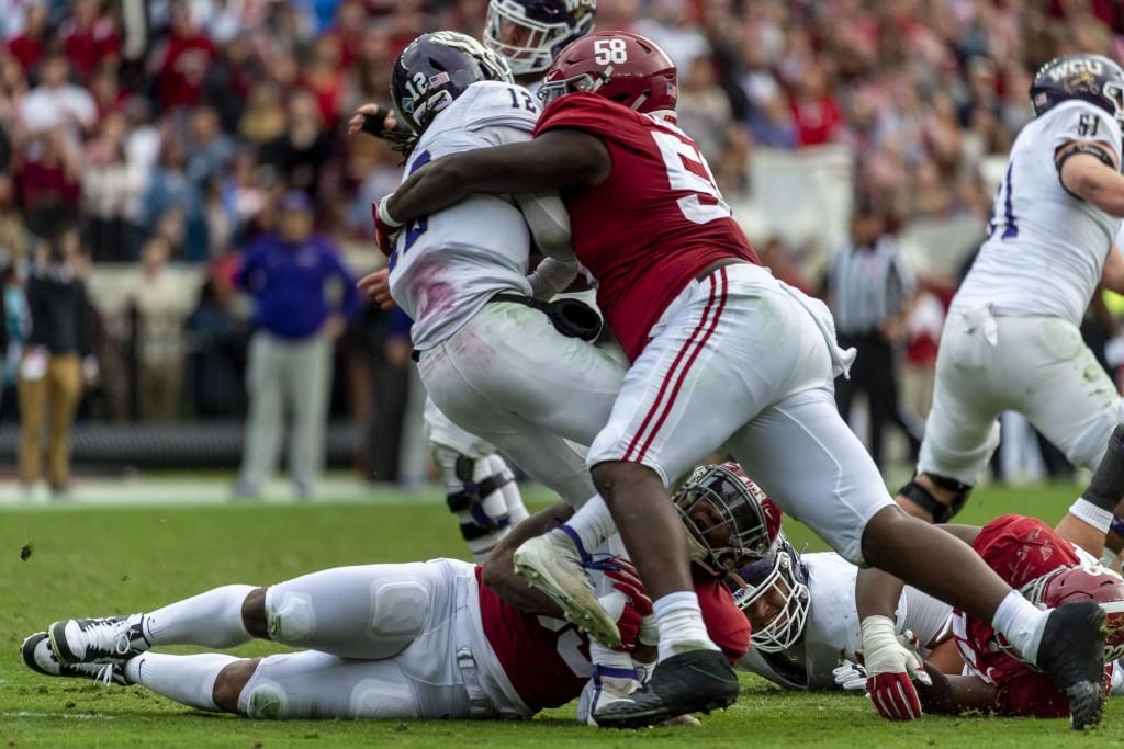 FILE - Alabama defensive lineman Christian Barmore (58) sacks Western Carolina quarterback Tyrie Adams (12) during the first half of an NCAA college f...