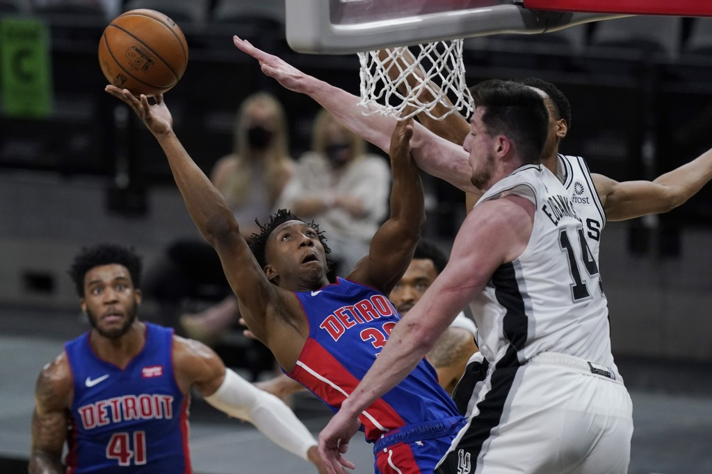 Detroit Pistons guard Saben Lee (38) shoots against San Antonio Spurs forward Drew Eubanks (14) during the second half of an NBA basketball game in Sa...