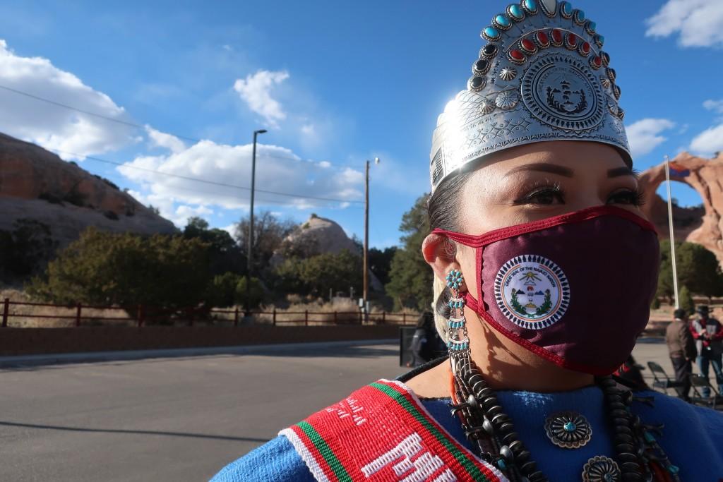 Miss Navajo Shaandiin Parrish awaits the arrival of First Lady Jill Biden at a Navajo Nation tribal park in Window Rock, Ariz., on Thursday, April 22,...