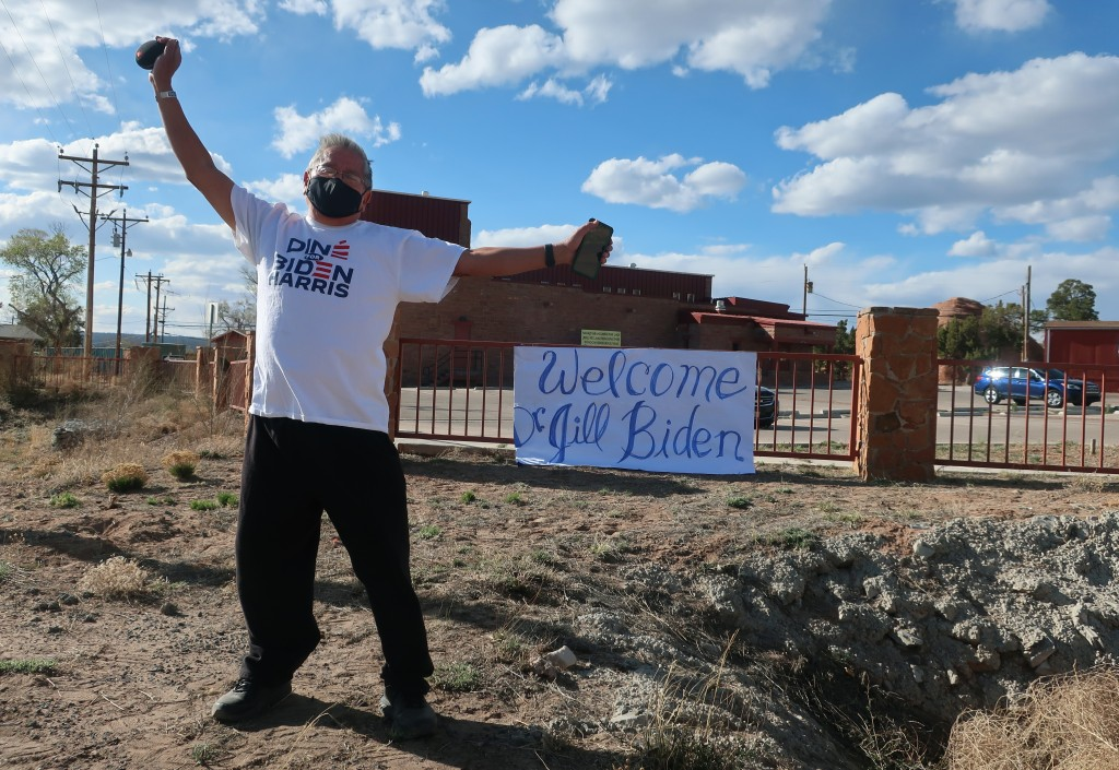 Tim Lewis, an artist from St. Michaels, Arizona, stands alongside a road in Window Rock, Arizona, hoping to get a glimpse of First Lady Jill Biden as ...