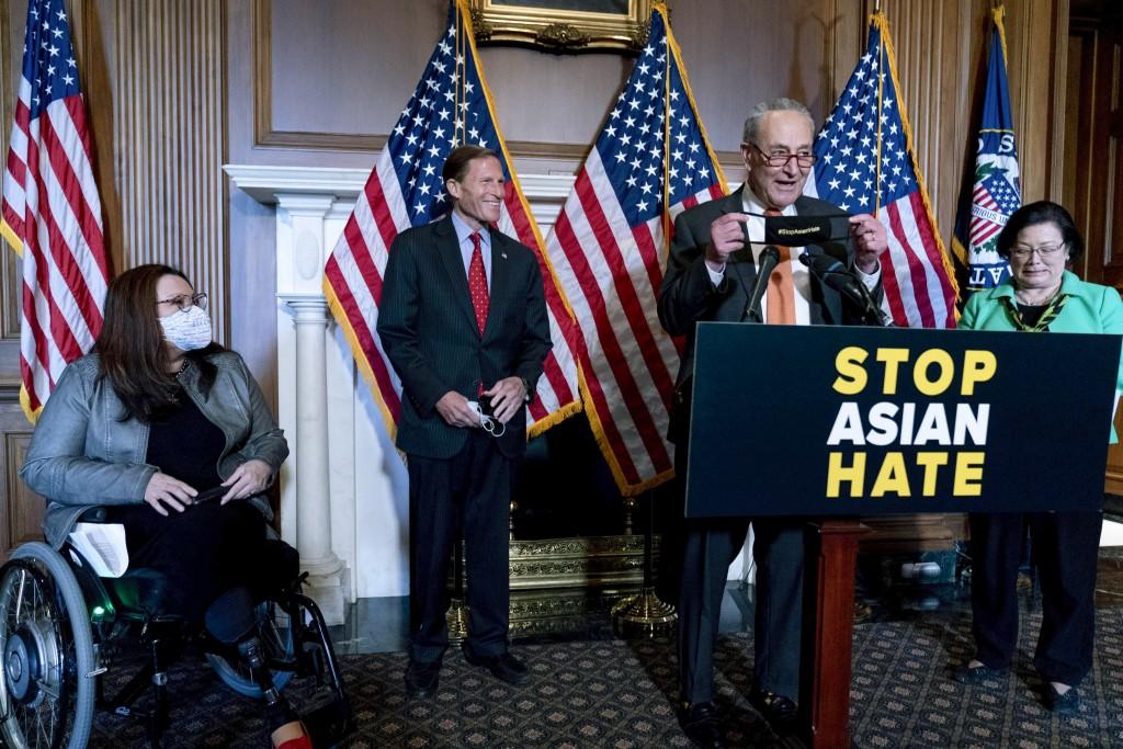 Senate Majority Leader Chuck Schumer of N.Y., accompanied by Sen. Mazie Hirono, D-Hawaii, Sen. Tammy Duckworth, D-Ill., and Sen. Richard Blumenthal, D...