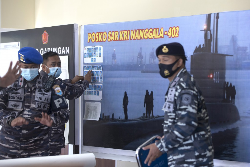 A member of Indonesian military officials sets the pictures of Indonesian Navy submarine KRI Nanggala that went missing while participating in a train...