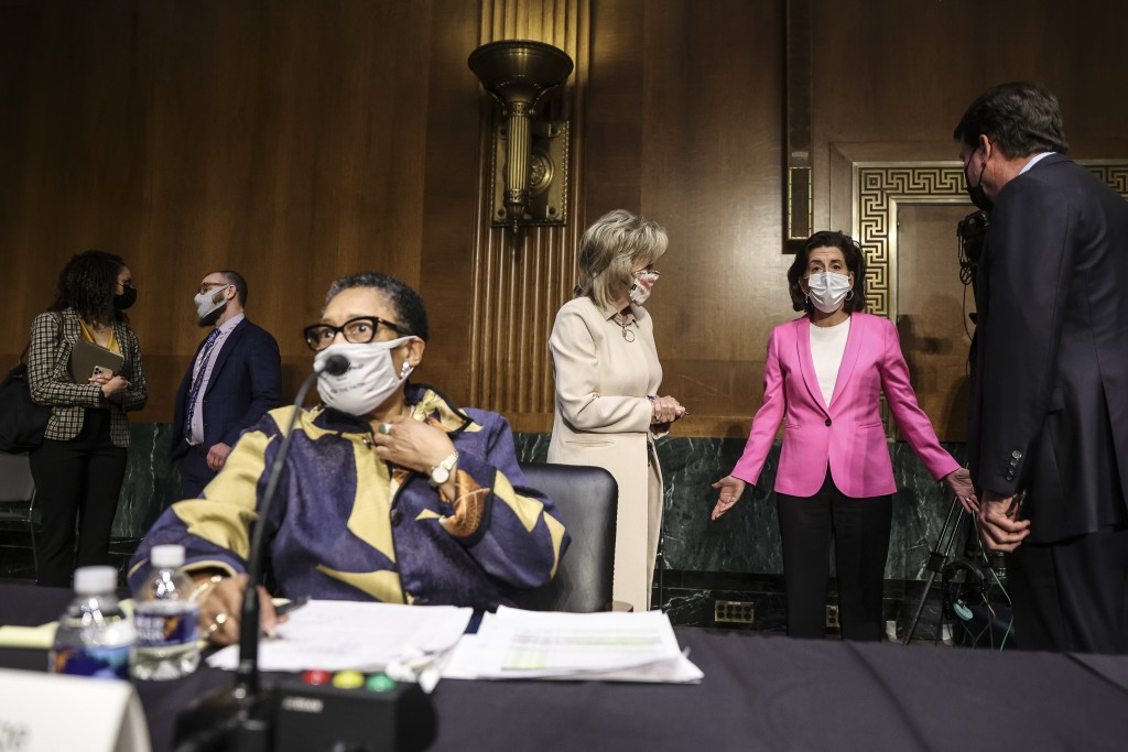Commerce Secretary Gina Raimondo, second right, speaks with, Sen. Cindy Hyde-Smith, R-Miss., and Sen. Bill Hagerty, R-Tenn., right, as Housing and Urb...