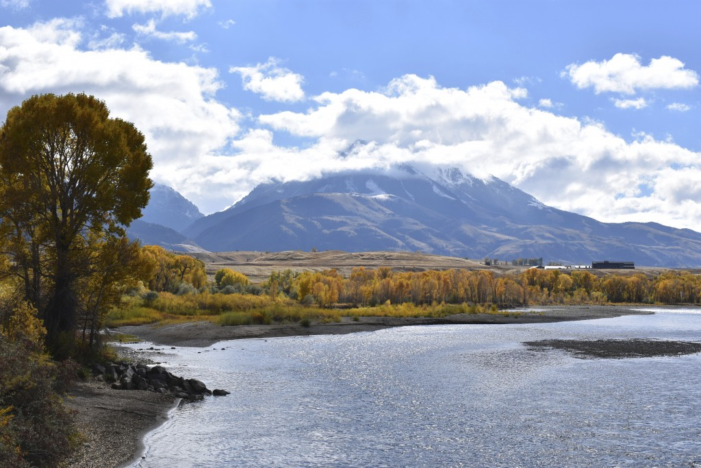 FILE - In this Oct. 8, 2018, file photo, Emigrant Peak is seen rising above the Paradise Valley and the Yellowstone River near Emigrant, Mont. The Bid...