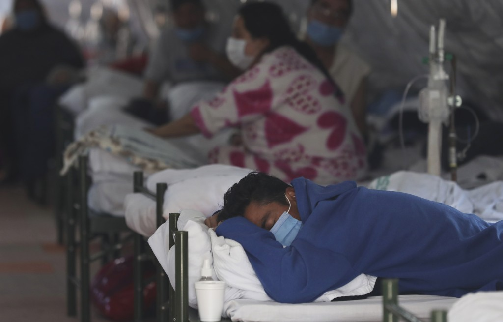 Patients undergo treatment for COVID-19 inside a tent installed outside the Social Security Hospital in Quito, Ecuador, Thursday, April 22, 2021. The ...