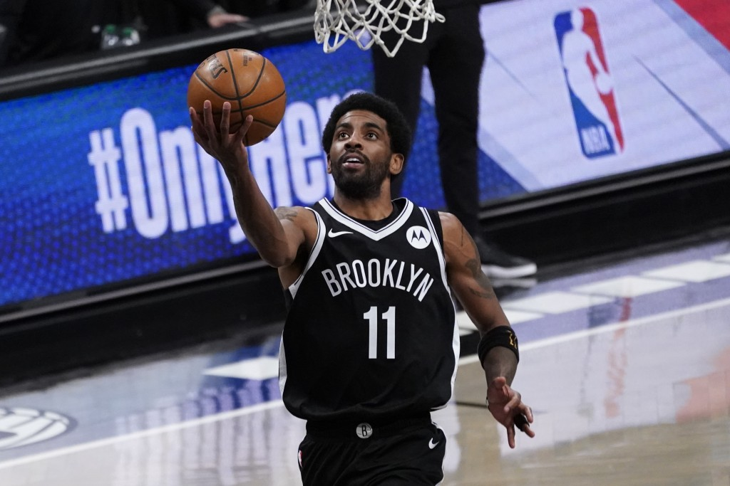 Brooklyn Nets guard Kyrie Irving goes to the basket during the second half of an NBA basketball game against the Boston Celtics, Friday, April 23, 202...