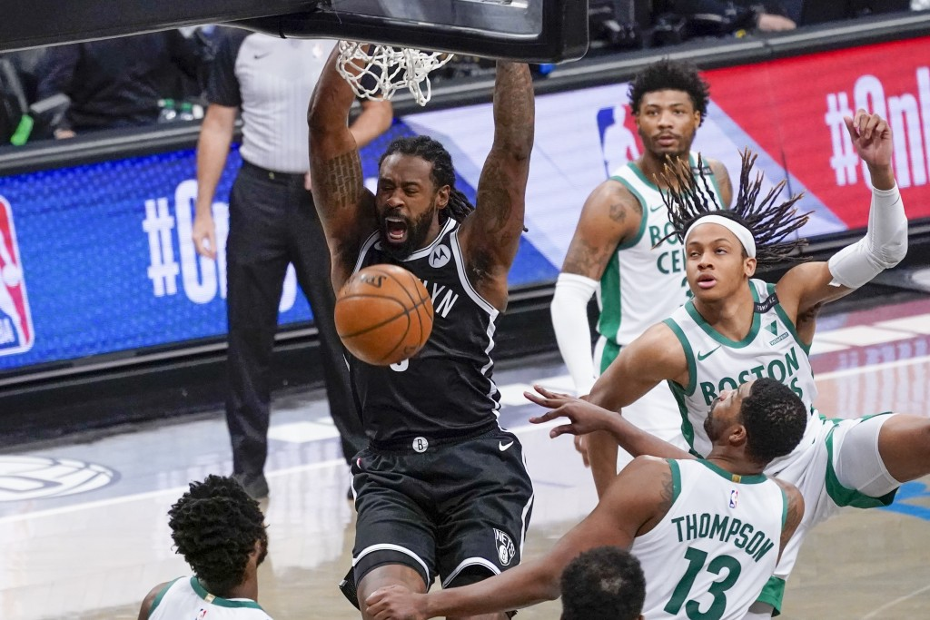 Brooklyn Nets center DeAndre Jordan dunks during the second half of an NBA basketball game against the Boston Celtics, Friday, April 23, 2021, in New ...