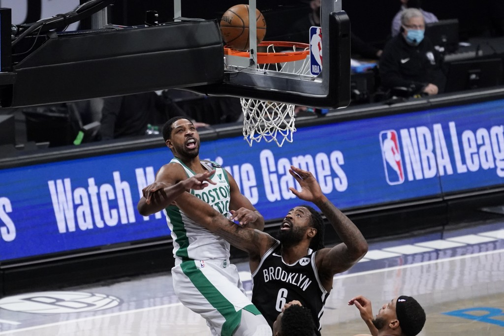 Boston Celtics center Tristan Thompson shoots past Brooklyn Nets center DeAndre Jordan (6) during the first half of an NBA basketball game, Friday, Ap...