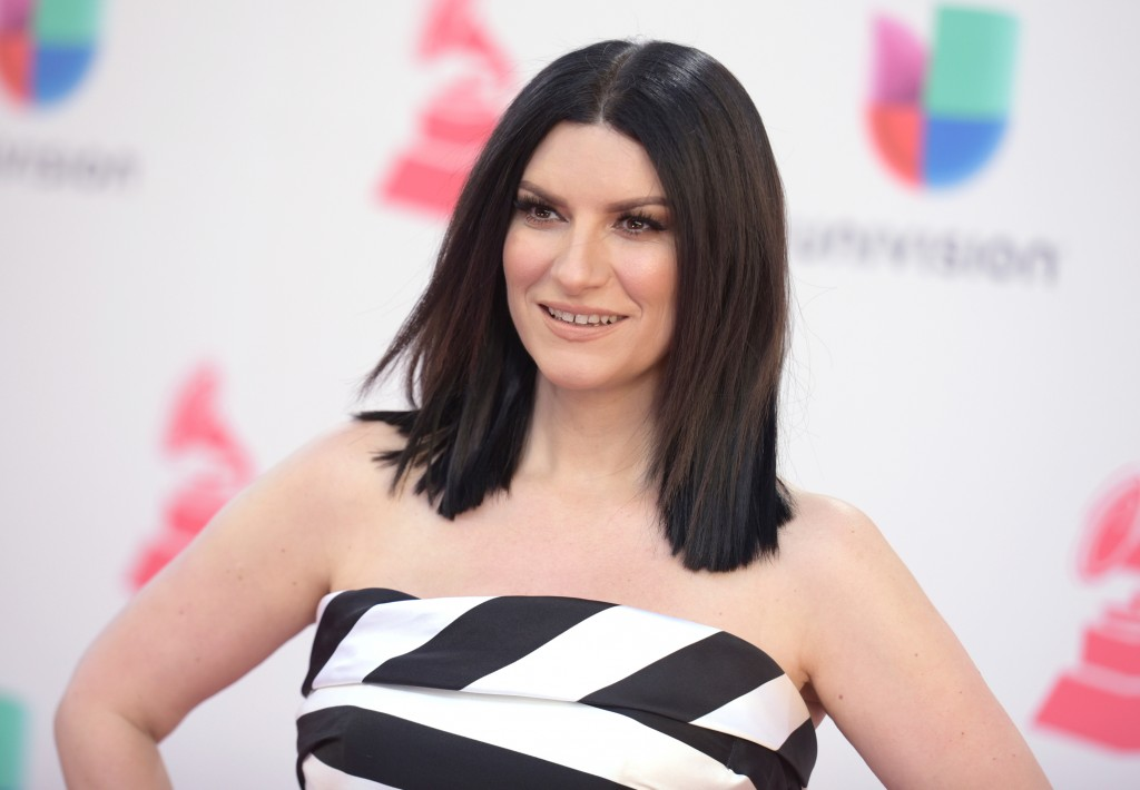 FILE - In this Nov. 17, 2016 file photo, Laura Pausini arrives at the 17th annual Latin Grammy Awards in Las Vegas. Pausini will perform her Oscar nom...