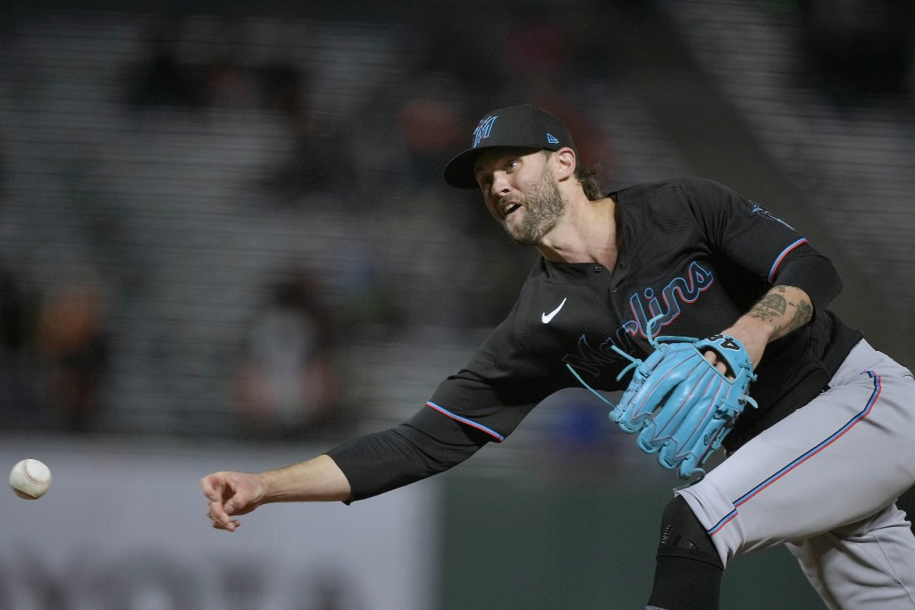 Miami Marlins relief pitcher Adam Cimber works against the San Francisco Giants during the sixth inning of a baseball game Friday, April 23, 2021, in ...