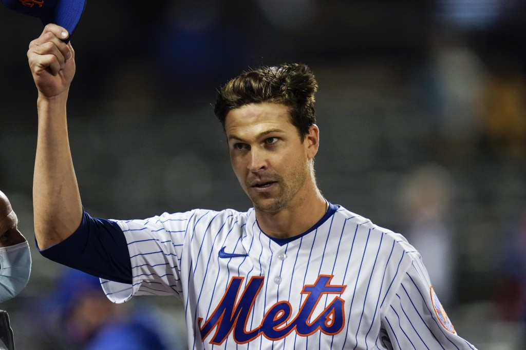 New York Mets starting pitcher Jacob deGrom tips his cap to fans after a baseball game against the Washington Nationals Friday, April 23, 2021, in New...