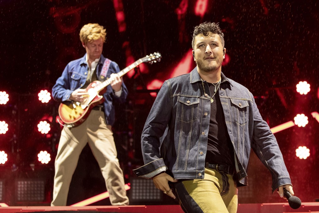 Ji Fraser, left, and Matiu Walters, of New Zealand band Six60, perform at Eden Park in Auckland, New Zealand, Saturday, April 24, 2021. Six60 is being...