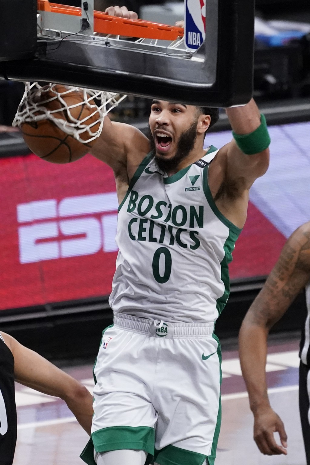 Boston Celtics forward Jayson Tatum dunks during the first half of an NBA basketball game against the Brooklyn Nets, Friday, April 23, 2021, in New Yo...