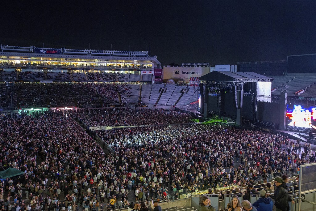 Fans fill the stadium as New Zealand band Six60 perform at Eden Park in Auckland, New Zealand, Saturday, April 24, 2021. Six60 is being billed as the ...