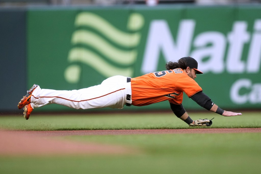 San Francisco Giants shortstop Brandon Crawford makes the stop on a ball hit by Miami Marlins' Garrett Cooper during the first inning of a baseball ga...