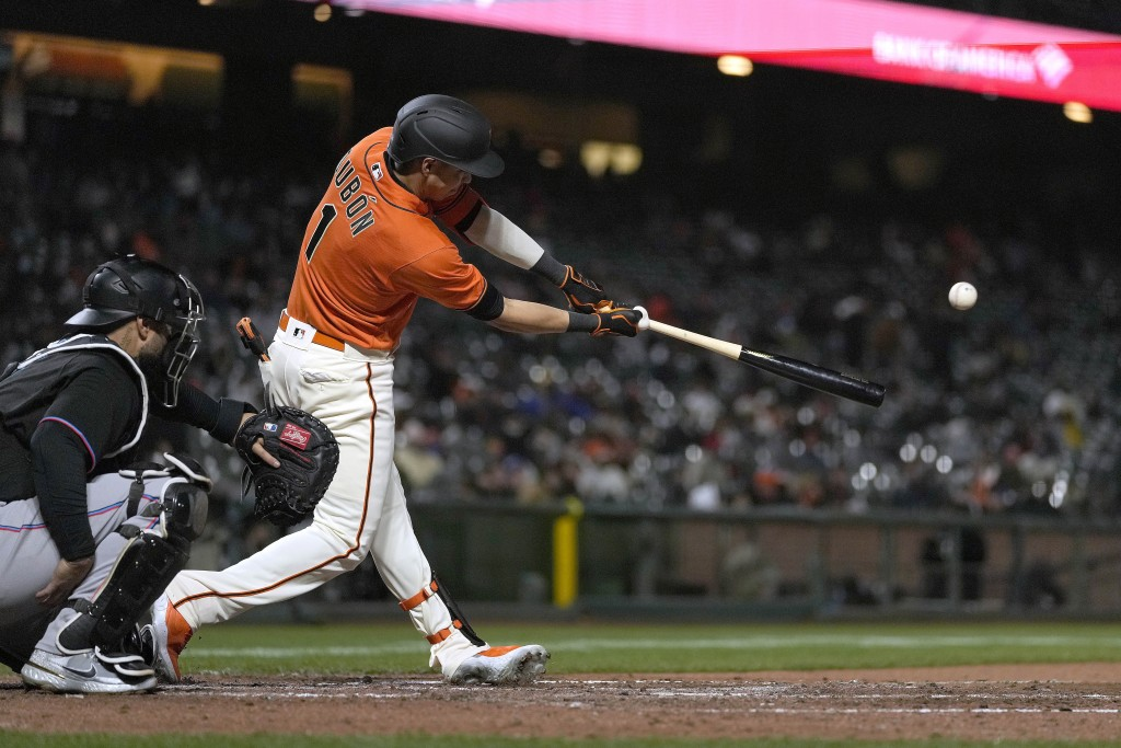 San Francisco Giants' Mauricio Dubon hits a double against the Miami Marlins during the seventh inning of a baseball game Friday, April 23, 2021, in S...