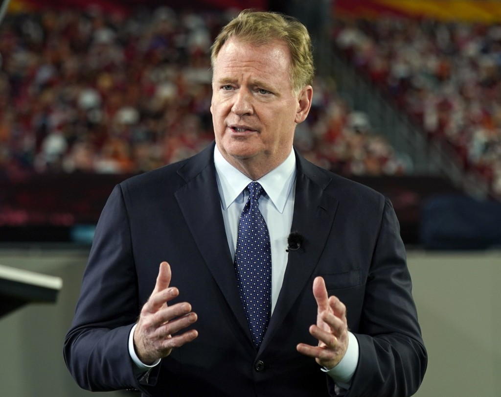 FILE - In this Feb. 5, 2021, file photo, NFL Commissioner Roger Goodell talks during a ceremony as part of Super Bowl 55 in Tampa, Fla. The NFL is mod...