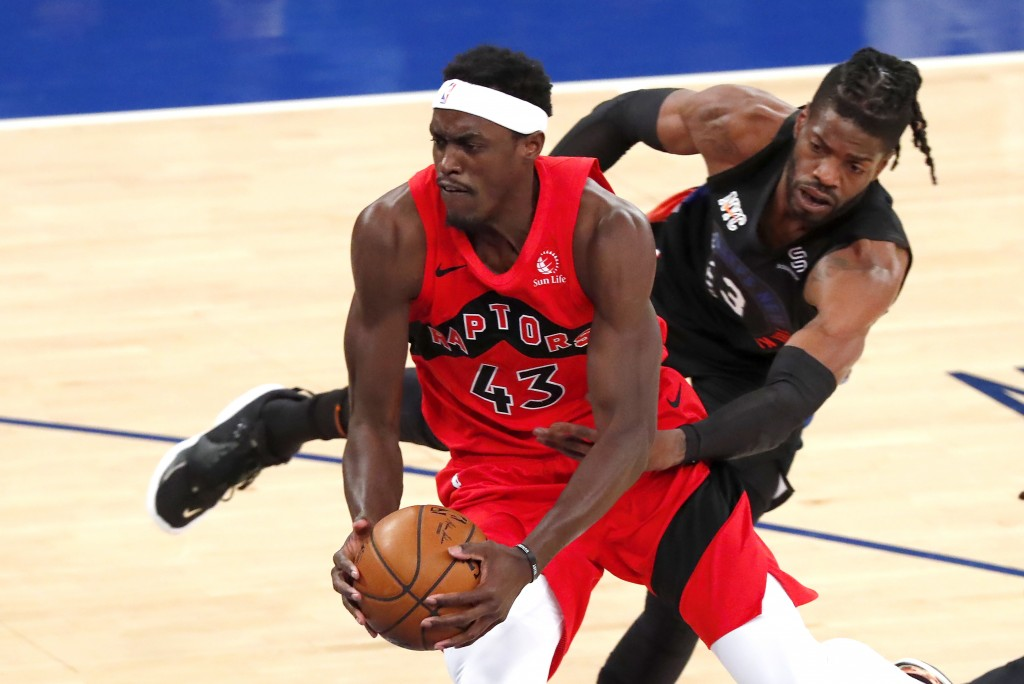 Toronto Raptors forward Pascal Siakam (43) drives to the basket against New York Knicks center Nerlens Noel (3) during the first half of an NBA basket...