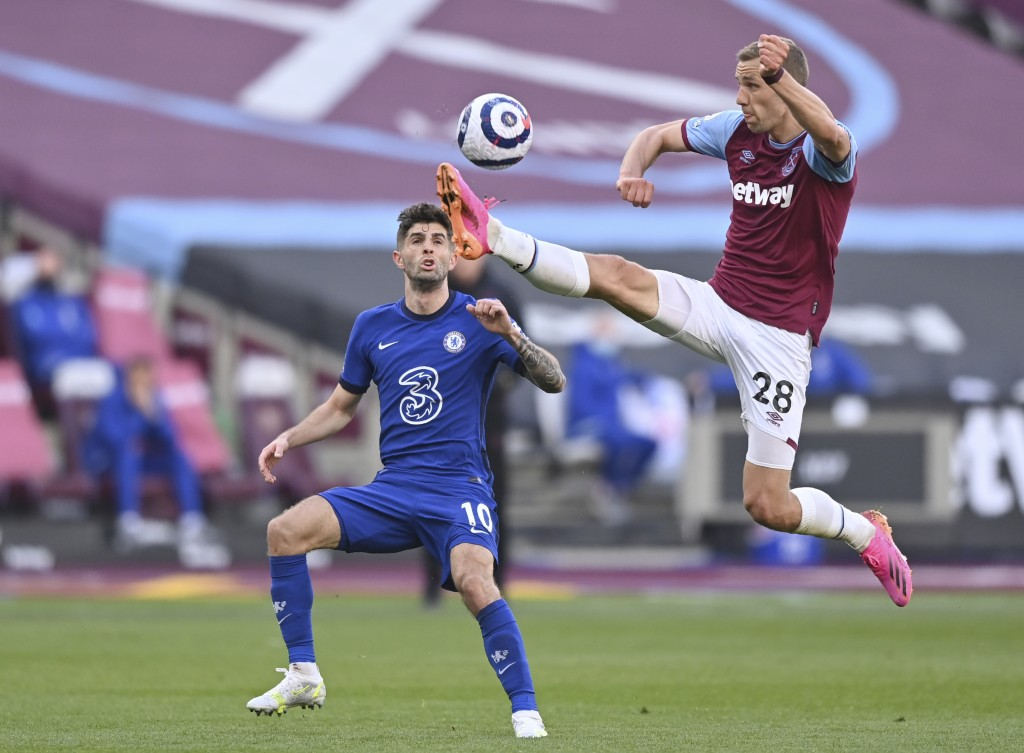 West Ham's Tomas Soucek, right, kicks the ball ahead of Chelsea's Christian Pulisic during the English Premier League soccer match between West Ham Un...