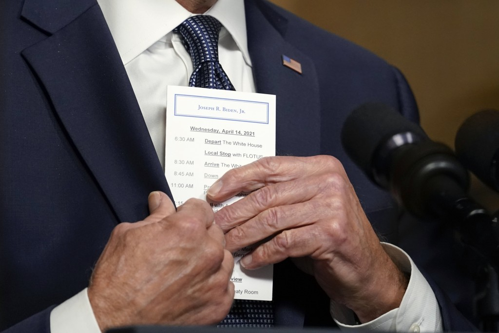 FILE - In this April 14, 2021, file photo President Joe Biden puts a card into his pocket as he speaks from the Treaty Room in the White House about t...