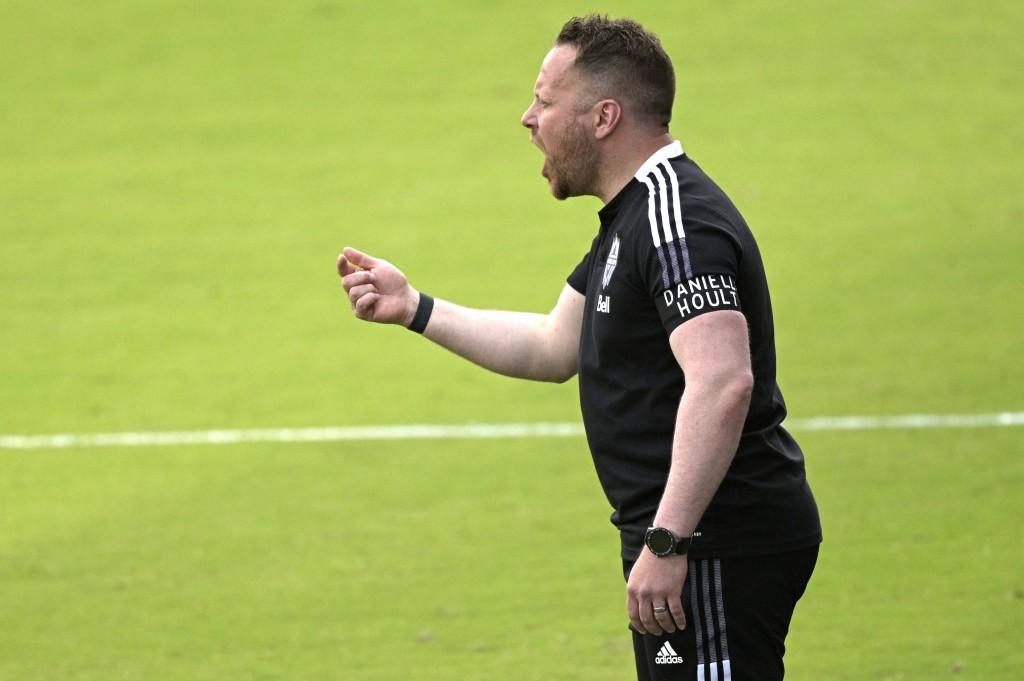Vancouver Whitecaps head coach Marc Dos Santos calls out instructions during the first half of an MLS soccer match against Toronto FC, Saturday, April...