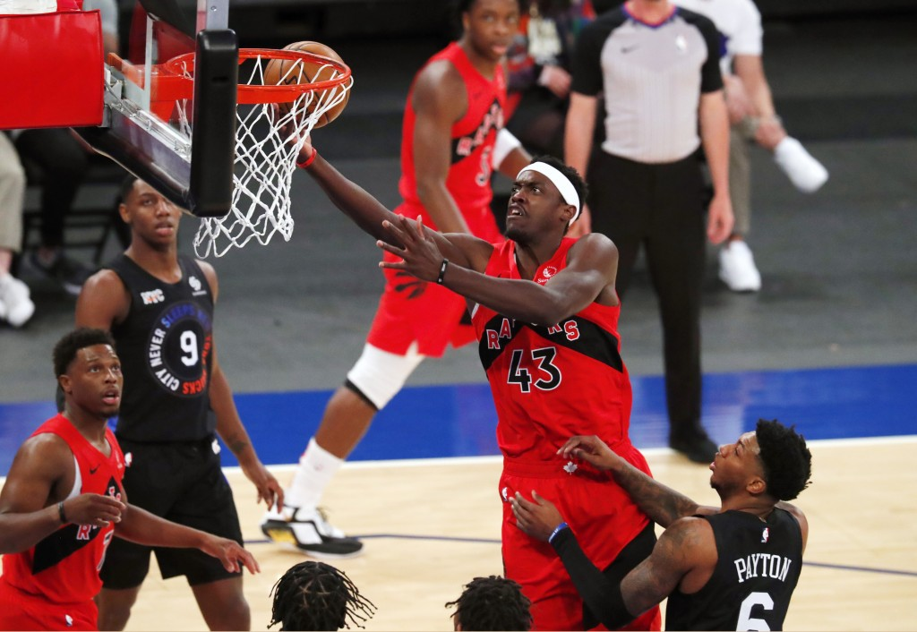 Toronto Raptors forward Pascal Siakam (43) goes to the basket against New York Knicks guard Elfrid Payton (6) during the first half of an NBA basketba...