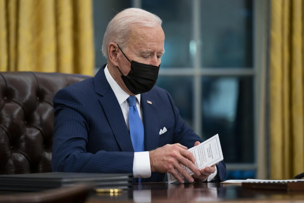 FILE - In this Feb. 2, 2021, file photo President Joe Biden delivers remarks on immigration, in the Oval Office of the White House in Washington. (AP ...