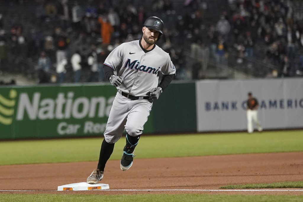 Miami Marlins' Jon Berti rounds the bases on his solo home run against the San Francisco Giants during the seventh inning of a baseball game in San Fr...