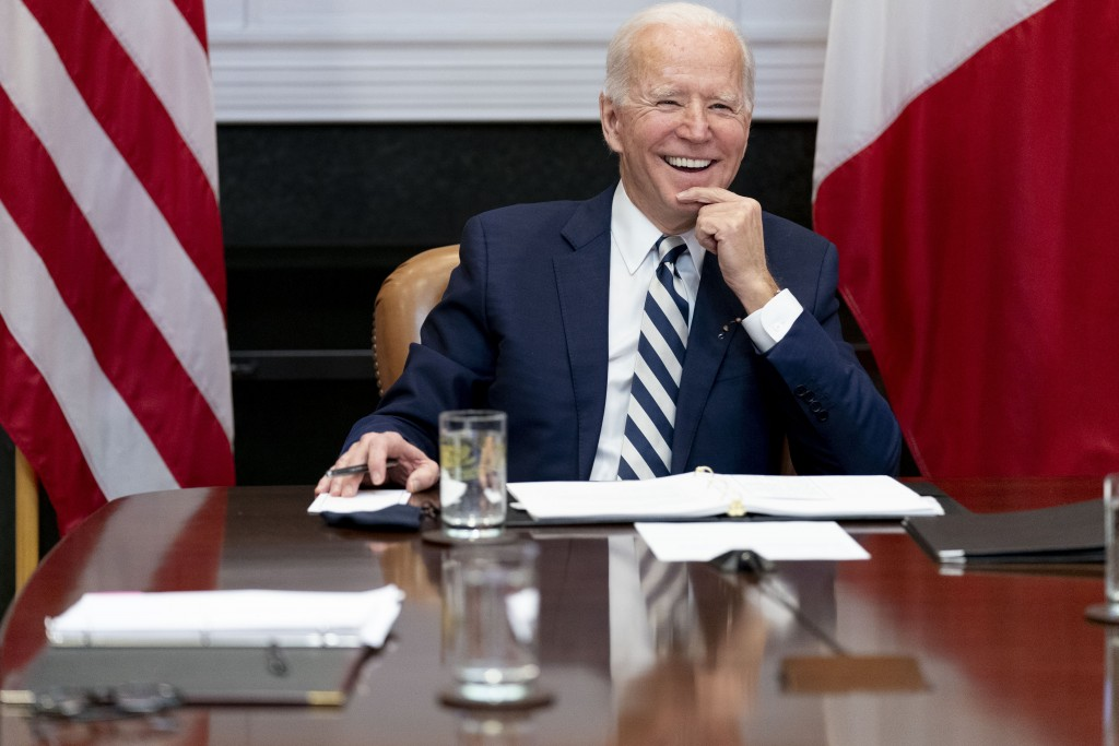 FILE - In this March 1, 2021, file photo President Joe Biden speaks during a virtual meeting with Mexican President Andres Manuel Lopez Obrador, in th...