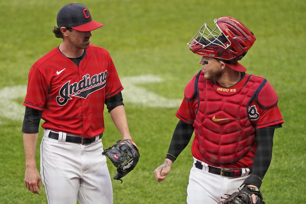 Cleveland Indians starting pitcher Shane Bieber, left, and catcher Roberto Perez walk to the dugout in the first inning of a baseball game against the...