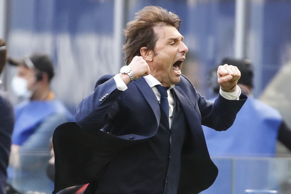Inter Milan's head coach Antonio Conte celebrates his side's 1-0 win at the end of the Serie A soccer match between Inter Milan and Hellas Verona, at ...