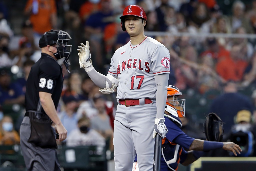 Los Angeles Angels designated hitter Shohei Ohtani (17) reacts to umpire Ryan Blakney (36) after getting called out on strikes as Houston Astros catch...