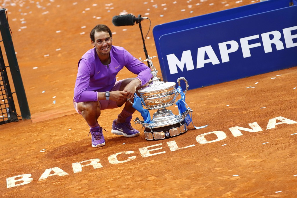 Rafael Nadal of Spain poses for a photo next to the trophy after winning the final Godo tennis tournament against Stefanos Tsitsipas of Greece in Barc...
