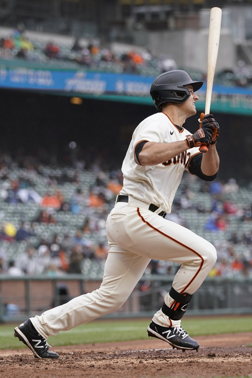 San Francisco Giants' Jason Vosler hits a single against the Miami Marlins during the fifth inning of a baseball game in San Francisco, Sunday, April ...