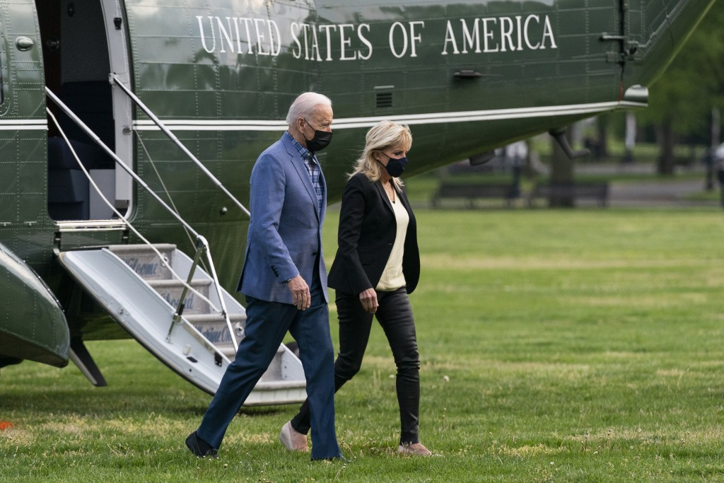 President Joe Biden walks from Marine One with first lady Jill Biden on the Ellipse near the White House after spending the weekend in Wilmington, Del...