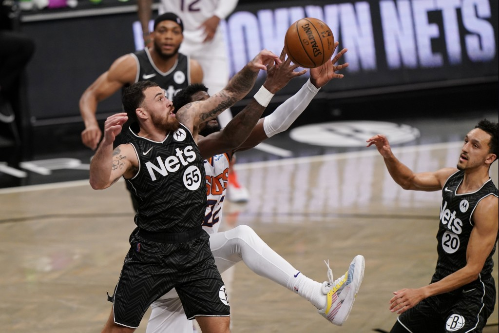 Brooklyn Nets guard Mike James (55) defends Phoenix Suns center Deandre Ayton (22) as Nets guard Landry Shamet (20) looks on from the floor during the...