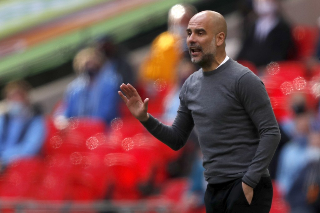 Manchester City's head coach Pep Guardiola gestures during the English League Cup final soccer match between Manchester City and Tottenham Hotspur at ...