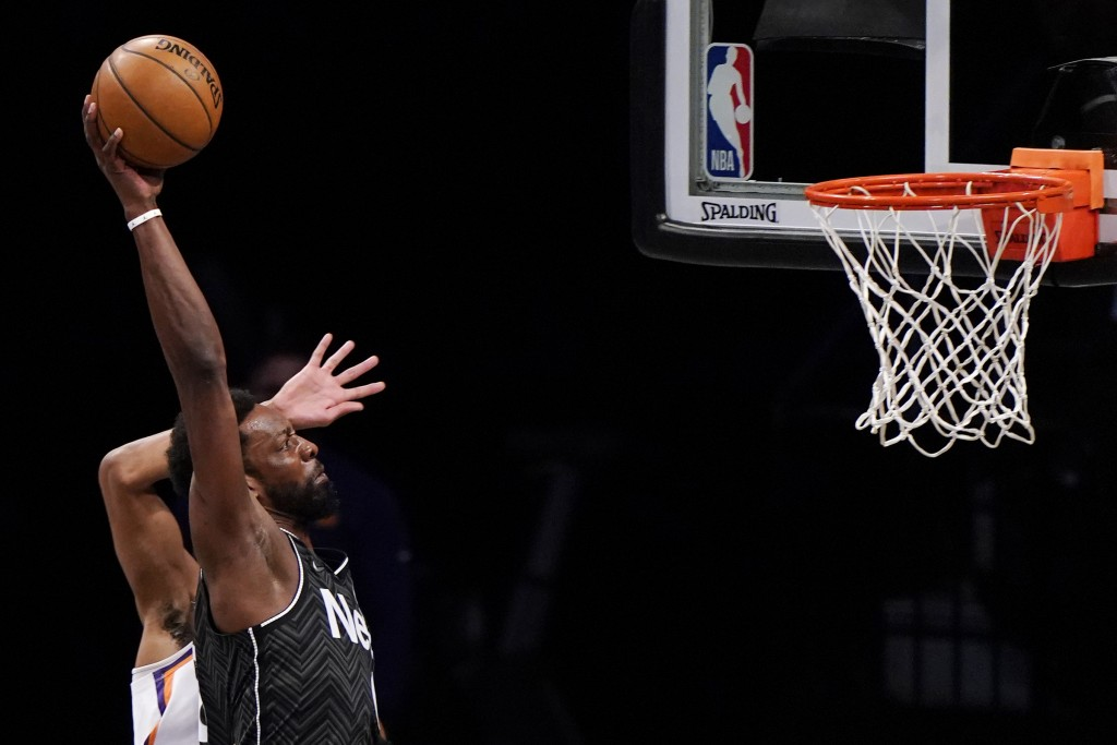 Brooklyn Nets forward Jeff Green (8) prepares to dunk the ball during the first quarter of an NBA basketball game Phoenix Suns, Sunday, April 25, 2021...