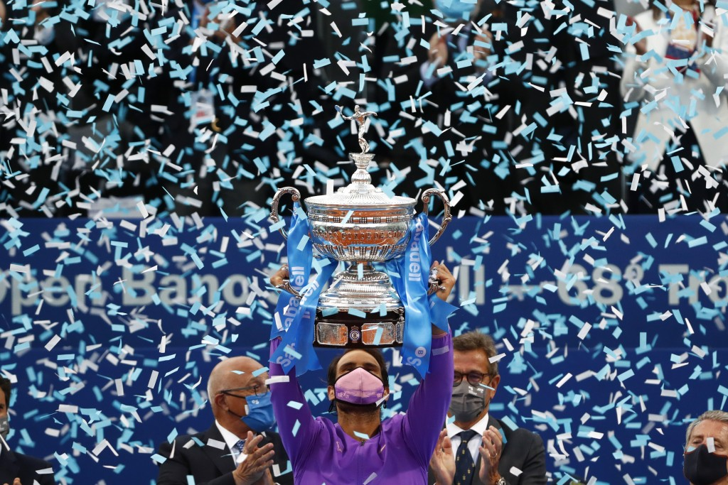 Rafael Nadal of Spain holds the trophy after winning the final Godo tennis tournament against Stefanos Tsitsipas of Greece in Barcelona, Spain, Sunday...